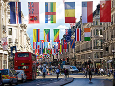 Flags hanging over a street in London's West End
