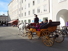 people in a horse-drawn carriage, one of the best things to do in Salzburg