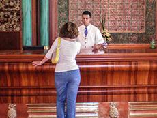 woman speaking with hotel clerk