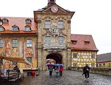 people walking past an old European painted building in Europe