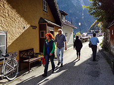 a couple walking along a street in a mountain town