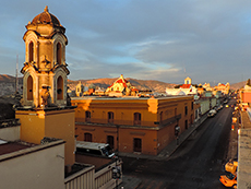an old Mexican church at sunset
