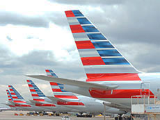 tails of airplanes together at an airport