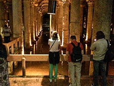 people viewing tall columns