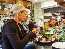 a woman eating in a restaurant - one of the enjoyable European experiences