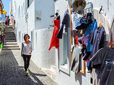woman walking by a shop in Europe