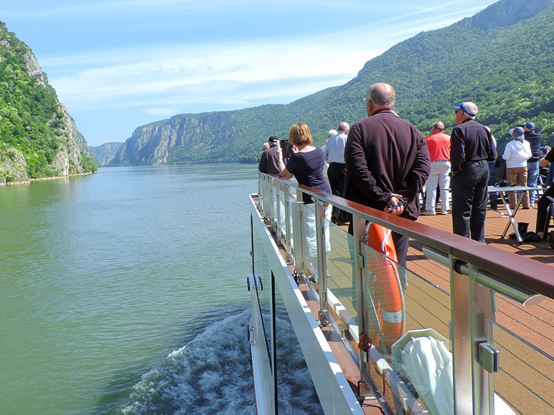 people on deck of a ship on a river cruise in Eastern Europe
