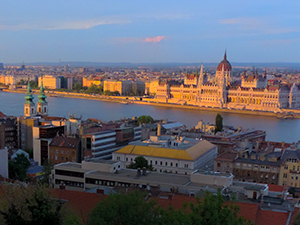 sunset on Hugnarian Parliament, seen on a river cruise in Eastern Europe