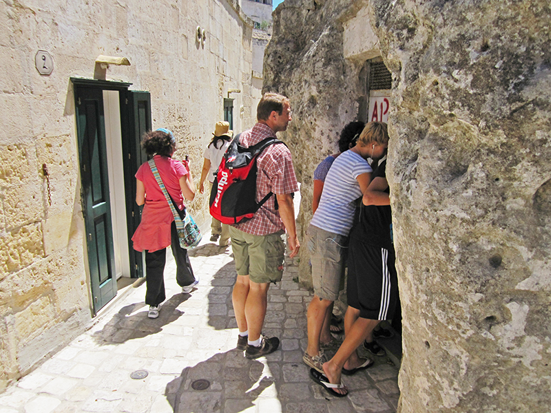 people looking into a Sassi cave
