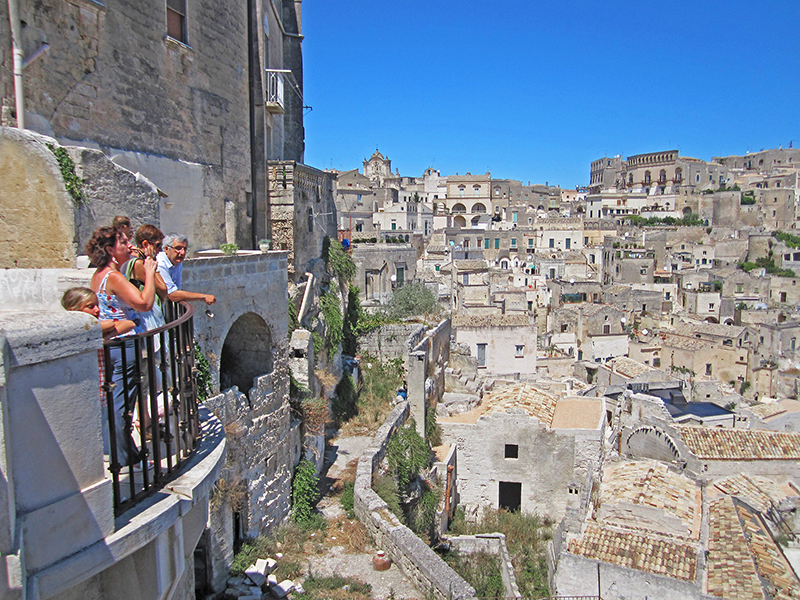 people looking out at the Sassi in Matera