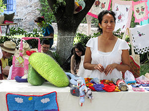 woman selling embroidery in a market