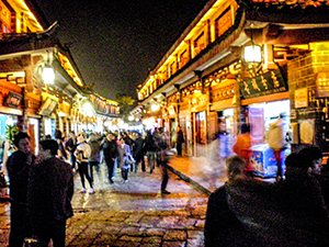 narrow street of an old city at night in Lijiang