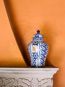 a blue vase on a shelf