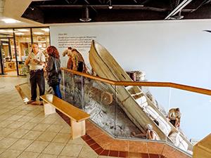 man and women talking near a musum exhibit