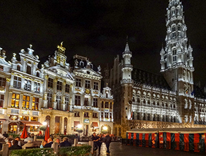 old european buildings lit up at night