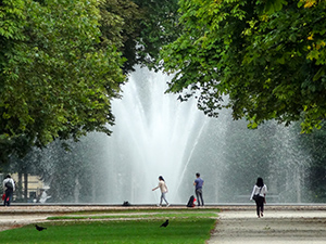 woman on a path near a park fountain in Brussels