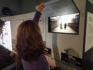 woman looking at an old photo exhibit
