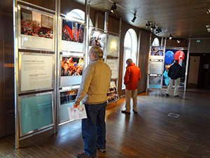 people looking at museum exhibits in Orlo