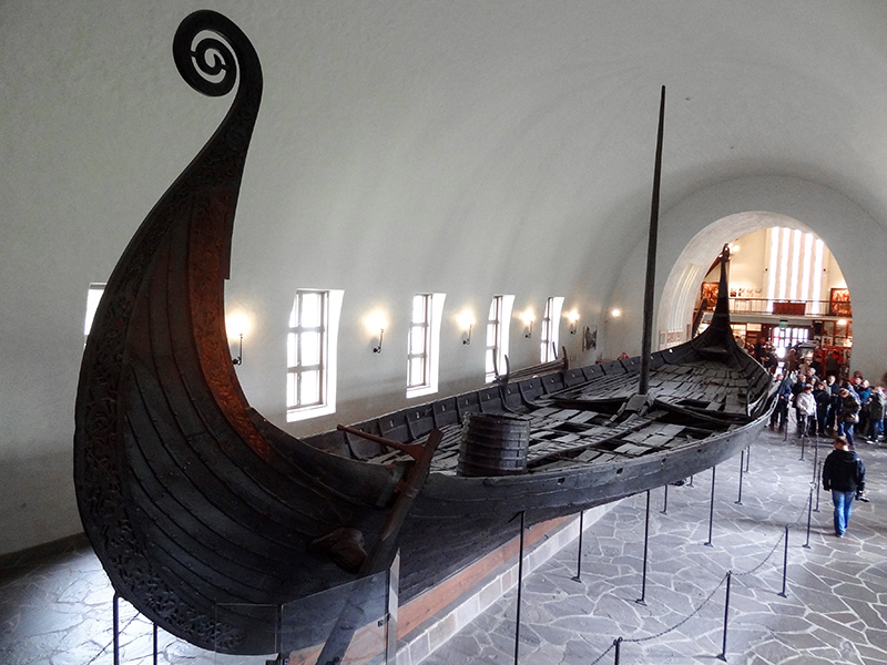 a large Viking ship in a museum Oslo
