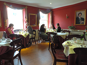 people in a tea room, a popular place to visit on a day trip from London