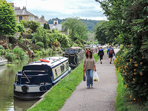 people walking along a towpath