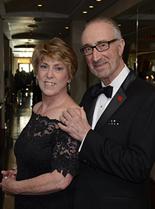 a couple in formal dress aboard the Cunard Queen Mary 2