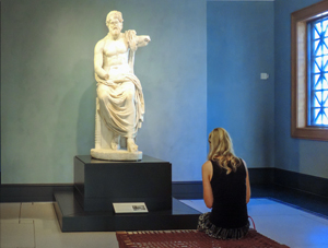 woman looking at a statue
