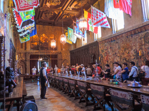 people and flags in an large ornate room