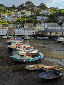 boats in mud at low tide in Polperro, one of the places to visit in Cornwall