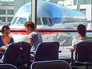 people at an airline gate near a plane