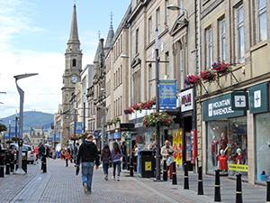 a pedestrian street with shops