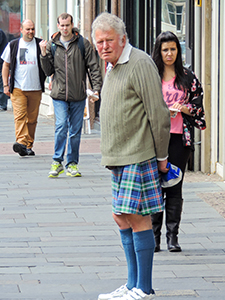 a man in a kilt seen in the Highlands of Scotland