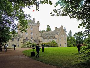 people by a castle