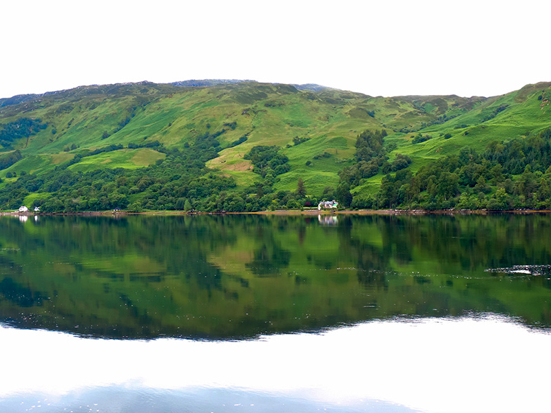 house on a large lake in the Highlands of Scotland