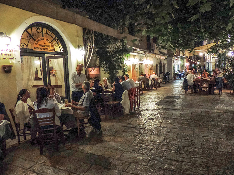 people sitting in cafes, one of the popular things to do in Corfu