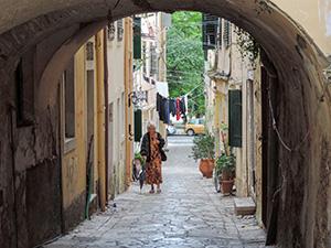 woman walking in an alley