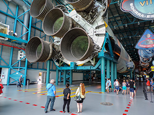 people looking at a rocket engine