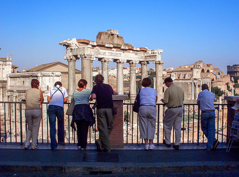 tourists viewing the Roman Forum, one of the top places to see in Rome