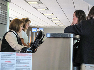 a woman at a ticket counter passengers should know how to be compensated for a delayed flight