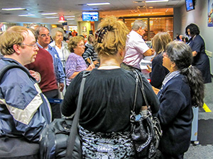 a crowd being told of a delayed flight - passengers should know how to be compensated for a delayed flight