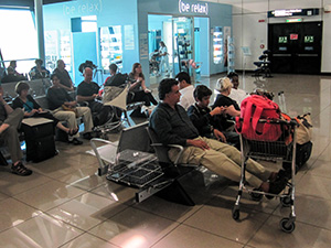 people sitting in an airport lounge