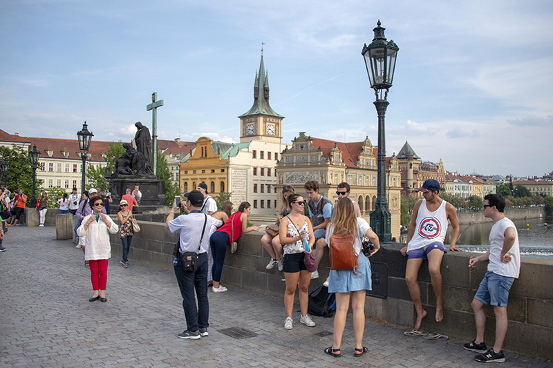 people on the Chrles Bridge, one of the places to see in Prague