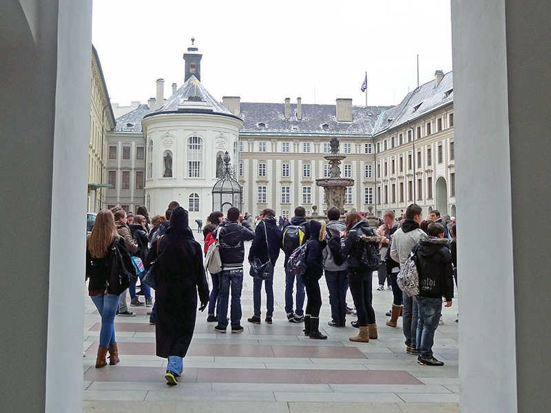 people in the courtyard of prague castle, one of the places to see in Prague
