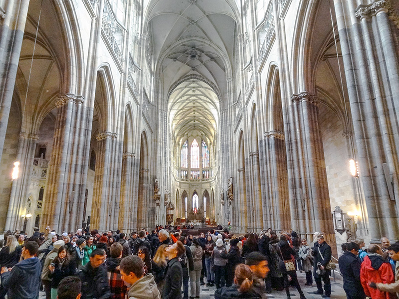 a crowd in St. Vitos Cathedral, one of the places to see in Prague