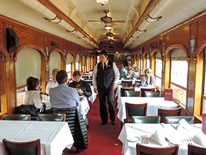 people in a train dining car