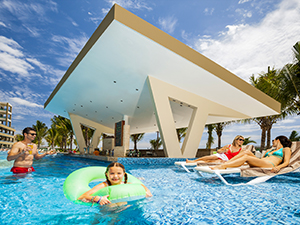 family in a hotel pool at a Riviera Maya hotel