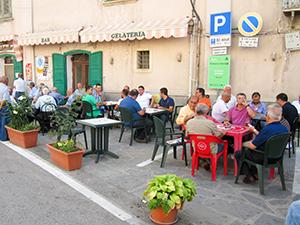 men sitting in a cafe