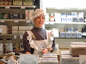 clerk in a shop in the Lake District in England