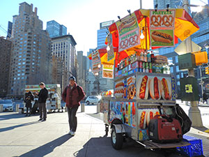 people by food carts, a good thing to do in New York in the winter