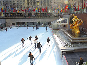 people ice skating, a good thing to do in New York in the winter